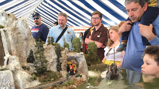 Visitors marvel of one of the many model railroad layouts